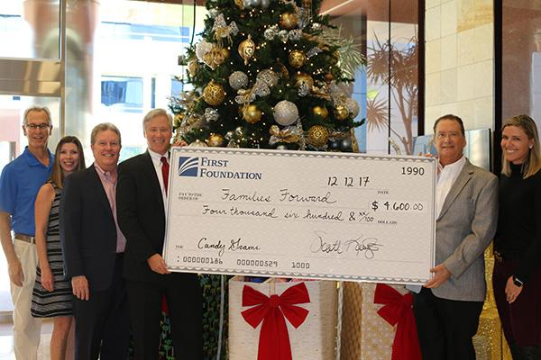 First Foundation donating check to Families Forward